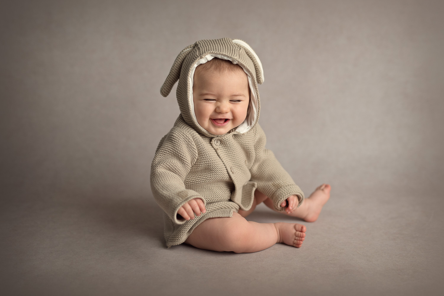 cute baby laughing in rabbit outfit