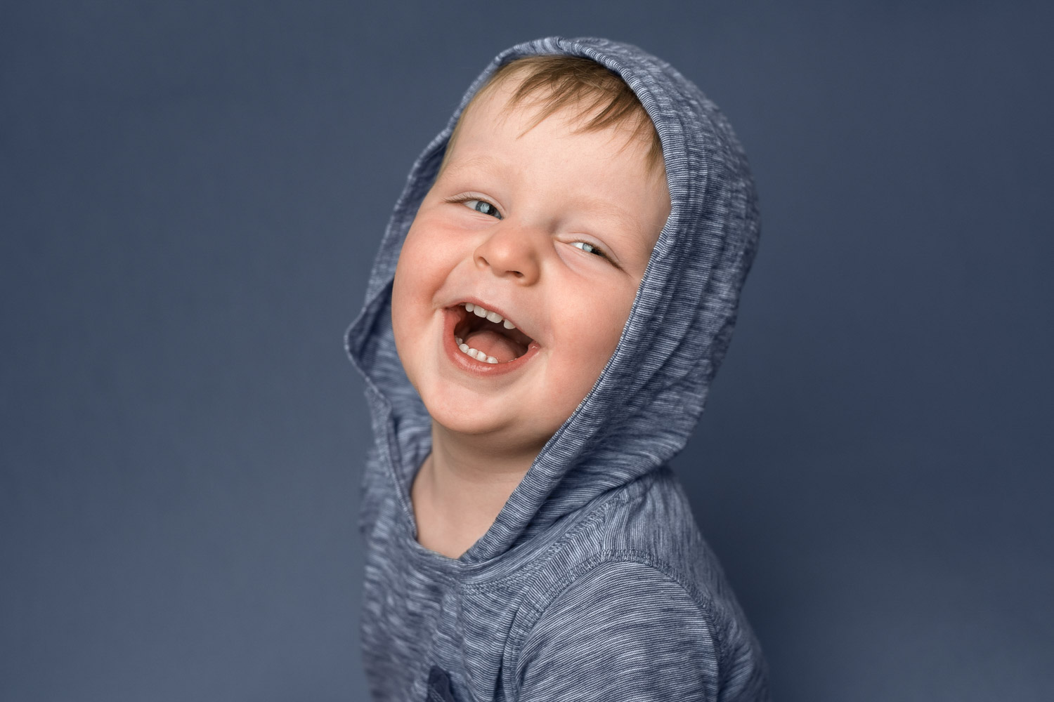 boy laughing photograph by siobhan kelly photography