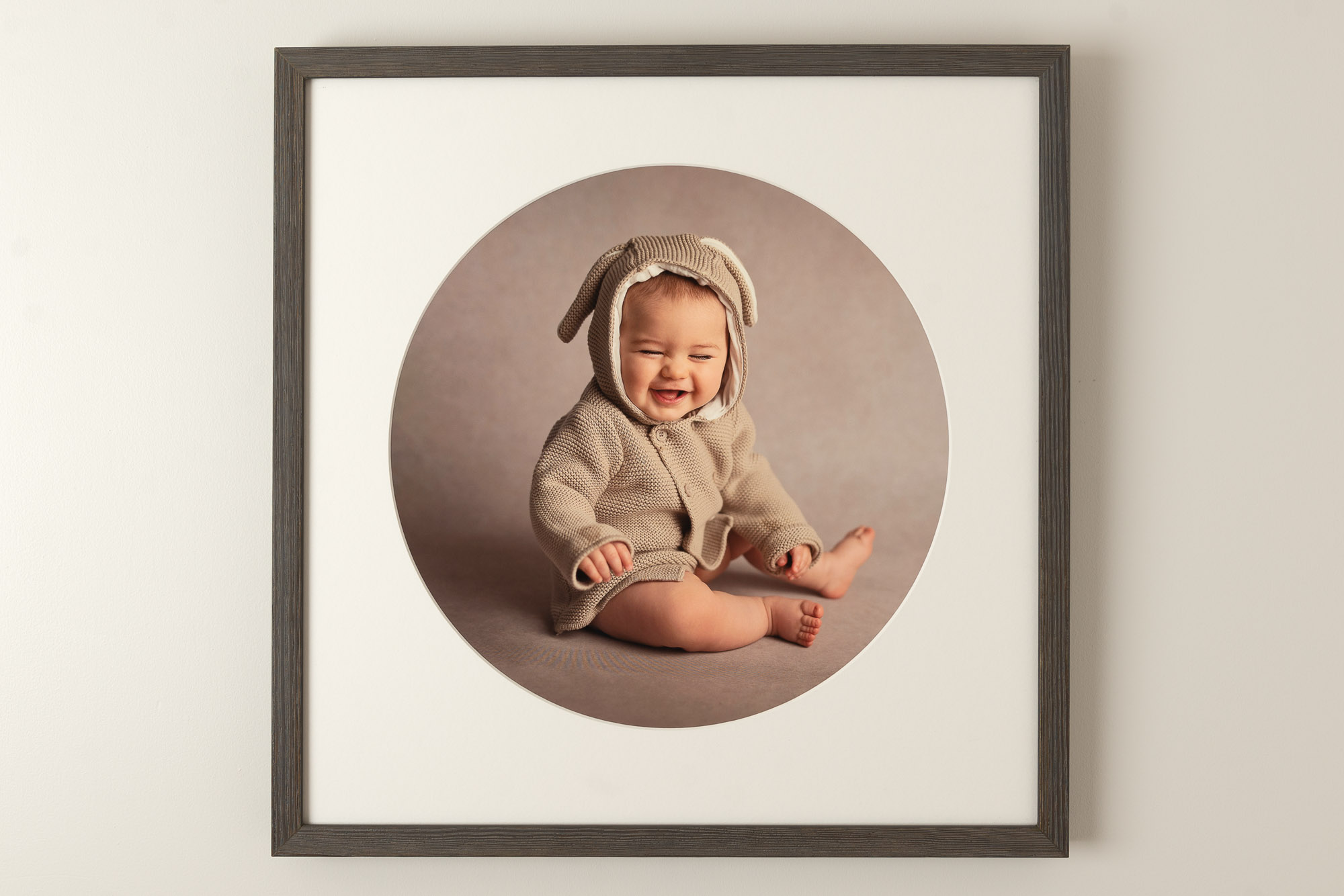 framed image of laughing baby